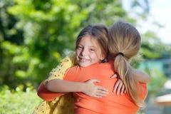 Mamas hug Stock Images