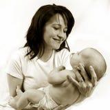 Mamma en weinig babymeisje Stock Foto's