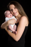 Mamma-Holding-Tochter stockfotos