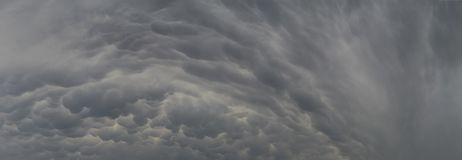 Mammatus Clouds Cumulonimbus. Clouds Mammatus are a grouping of clouds, which usually indicate the imminence of a storm stock image