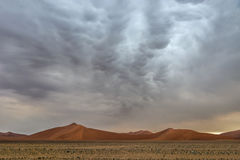 Mammatus stormy clouds over Sossusvlei dunes. Namibia Stock Image