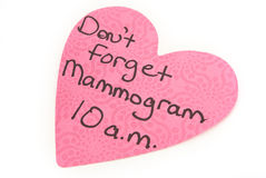 Mammogram Reminder Note Isolated On White. A friendly reminder to not forget to get your mammogram to avoid getting breast cancer or catching it in time royalty free stock images