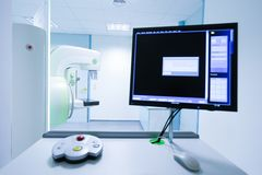 Mammograph and computer. Mammography breast screening device in hospital laboratory with computer display in foreground royalty free stock photography