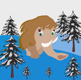 Mammoth goes on snow wood. Prehistorical animal mammoth goes on winter wood Royalty Free Stock Image