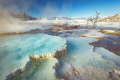 Free Mammoth Hot Springs With Steamy Terraces During Winter Snowy Season In Yellowstone National Park, Wyoming Stock Photos - 175221653