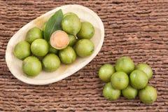 Mamoncillo delicious tropical fruit - Melicoccus bijugatus. Fresh ripe peeled quenepa fruit - Melicoccus bijugatus Stock Photo