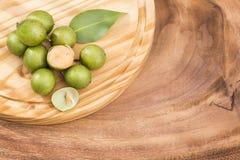 Mamoncillo delicious tropical fruit - Melicoccus bijugatus. Fresh ripe peeled quenepa fruit - Melicoccus bijugatus Stock Photos