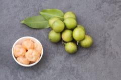 Fresh ripe peeled quenepa fruit - Melicoccus bijugatus. Mamoncillo delicious tropical fruit - Melicoccus bijugatus Royalty Free Stock Photography
