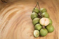 Mamoncillo delicious tropical fruit - Melicoccus bijugatus. Fresh ripe peeled quenepa fruit Stock Photo