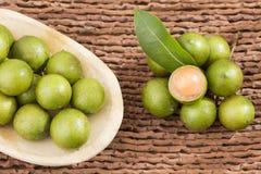Mamoncillo delicious tropical fruit - Melicoccus bijugatus. Fresh ripe peeled quenepa fruit - Melicoccus bijugatus Royalty Free Stock Photos