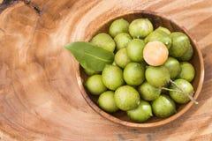 Mamoncillo delicious tropical fruit - Melicoccus bijugatus. Fresh ripe peeled quenepa fruit - Melicoccus bijugatus Stock Photography