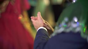 Man's hand doing applause at wedding.