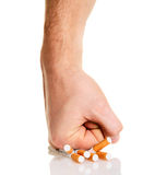 Man�s fist crushing cigarettes Royalty Free Stock Photography