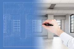 Man's hand drawing loft room blueprint Royalty Free Stock Photo