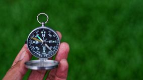 Hand holding compass. Royalty Free Stock Image