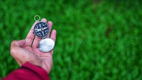 Man's hand holding a compass. Stock Photo