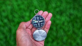 Man's hand holding a compass.Travel concept. Stock Images