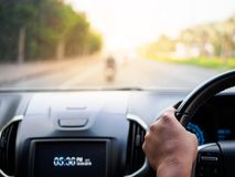 Man's hands holding steering wheel and blur road background. D. Riving concept Royalty Free Stock Photos