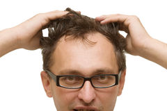 Man�s head with hands on the hair Royalty Free Stock Photography