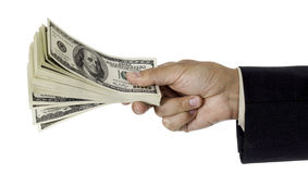 Man�s hand giving pack of dollars Royalty Free Stock Images