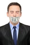 Man with a 100 dollar banknote on his mouth Royalty Free Stock Photo