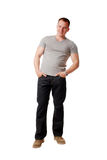 Man. A happy young man in jeans and a shirt on a white background Stock Photos