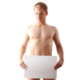 Man. Young muscular nude man covering a copy space blank billboard isolated on white Stock Images