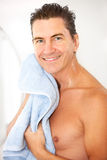 Man. Smiling handsome man in the bathroom Stock Photography