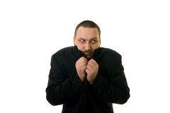 Man. In black with his head inside a black coat Stock Photography