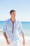 Man. Attractive beach walking successful man Stock Image