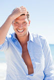 Man. Healthy man care on blue sea Royalty Free Stock Photography
