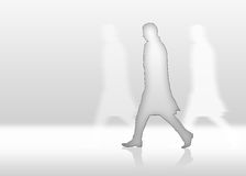 Man. Is walkin fast and alone in front of white background Royalty Free Stock Photos