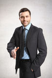 A man. Handsome businessman wearing suit. shake hands Stock Photography