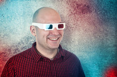 Man with 3d anaglyph glasses. Portrait of a smiling man with anaglyph glasses enjoying a 3d movie stock photos