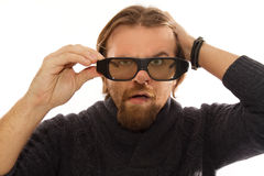 Man with 3D glasses. Red bearded watching TV in 3D stock photo