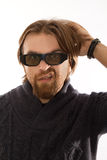 Man with 3D glasses. Red bearded watching TV in 3D stock image