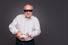 Man in 3d glasses with joystick Stock Image