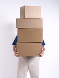Man with 4 stacked Boxes Royalty Free Stock Image