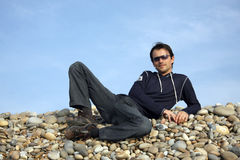 Man. Casual man on beach on blue sky Royalty Free Stock Photo