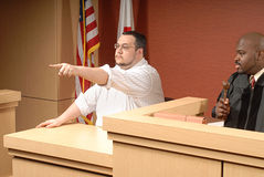That is the man. Witness confidently pointing out someone in the courtroom royalty free stock image