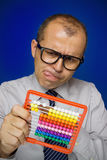 Man with abacus calculator Royalty Free Stock Photos