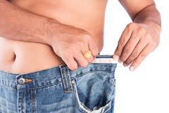 Man abdomen with measuring tape. On white background Royalty Free Stock Photos