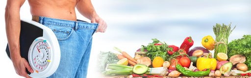Man abdomen with scales. Male waist with big jeans over abstract background Stock Photos