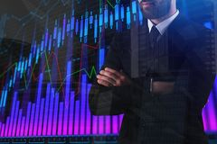 Man with abstract forex chart. Finance and fund management concept. Double exposure Royalty Free Stock Photos