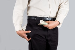 Man with abundant of money in his pockets and holding some money Royalty Free Stock Photography