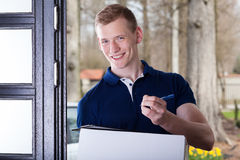 Man accepting a package Royalty Free Stock Photo
