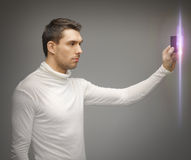Man with access card. Picture of futuristic man with access card Royalty Free Stock Image