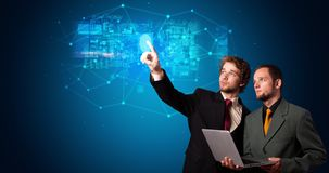 Man accessing hologram with fingerprint. Man accessing modern hologram personal database with fingerprint identification royalty free stock images