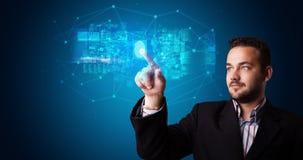 Man accessing hologram with fingerprint. Man accessing modern hologram personal database with fingerprint identification stock photo