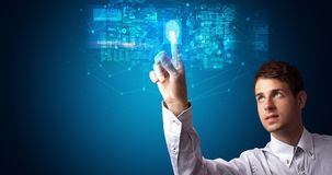 Man accessing hologram with fingerprint. Man accessing modern hologram personal database with fingerprint identification royalty free stock photography